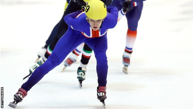 Elise Christie in action in Turin