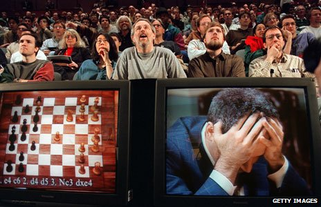 Chess enthusiasts watch Garry Kasparov on a television monitor in 1997