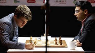 Magnus Carlsen and  Vishy Anand