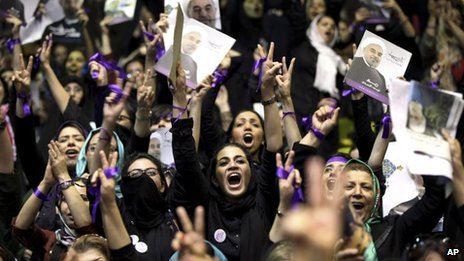Supporters of Hassan Rouhani cheer at a campaign rally in Tehran in June 2013