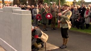 People in UVF costumes laid wreathes at the war graves commission memorial