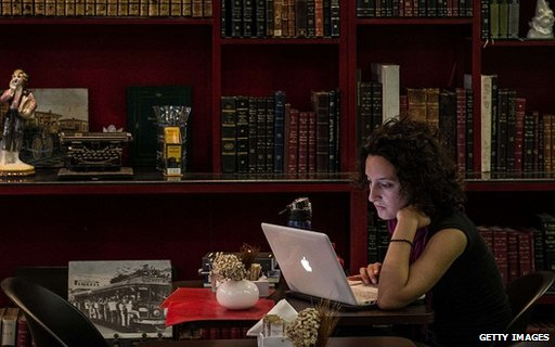 Woman uses laptop in Rio de Janeiro