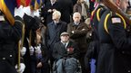 World War II veteran, Harry Marrington, centre, from Portsmouth, England, watches from his wheelchair during an Armistice Day ceremony under the Menin Gate in Ypres, Belgium