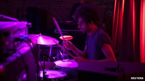 Drummer Arash Farazmand of indie band the Yellow Dogs performs at the Brooklyn Bowl in Williamsburg neighbourhood in New York on 11 November 2011