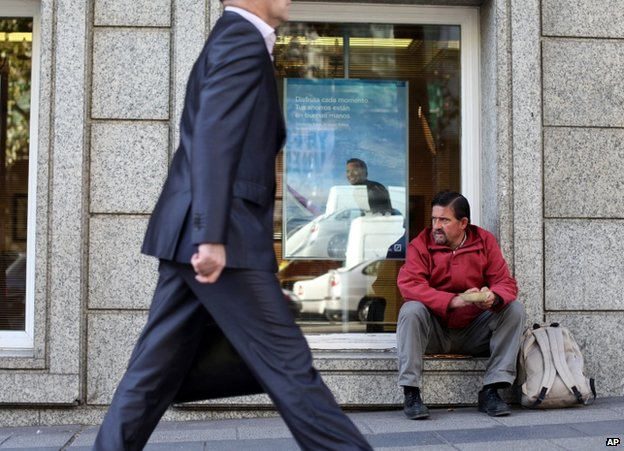Unemployed decorator Jose Oliver, 41, begs for money in Madrid, 29 October