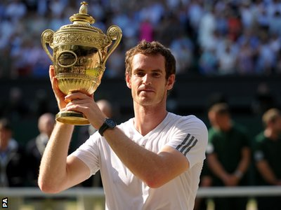 Andy Murray celebrates with the trophy after defeating Serbia's Novak Djokovic in the Wimbledon Men's Final