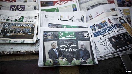 A file picture taken on on September 28, 2013, shows Iranian newspapers with pictures depicting Iranian President Hassan Rouhani, US President Barack Obama, Iranian Foreign Minister Mohammad Javad Zarif and his American counterpart John Kerry on a newsstand in Tehran