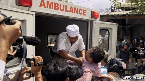 A demonstrator is carried to an ambulance