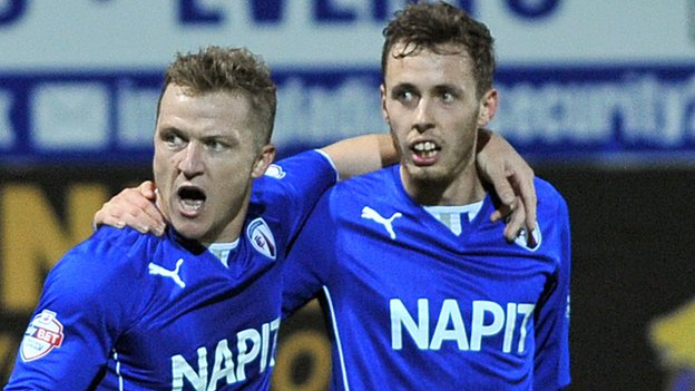Gary McSheffrey and Jamie Devitt celebrate scoring for Chesterfield