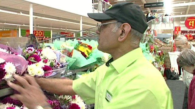older worker in supermarket