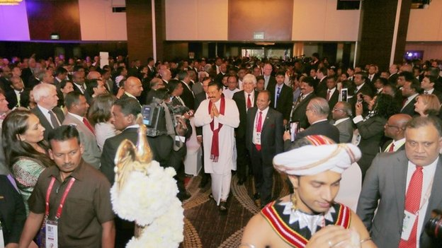 In this handout photo provided by Sri Lankan Government, Sri Lankan President Mahinda Rajapaksa (C) attends the inaugural session of The Commonwealth Business Forum on November 12, 2013 in Colombo, Sri Lanka.