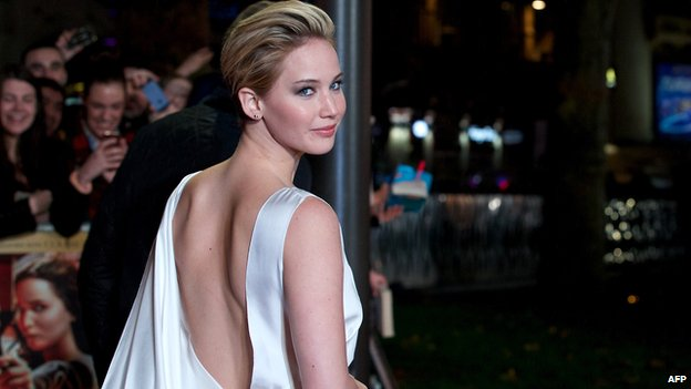 US actress Jennifer Lawrence poses for pictures on the red carpet upon arrival for the world premiere of the film.
