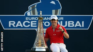 Rory McIlroy with last year's trophy