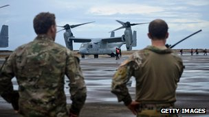 Unidentified soldiers stand near a V-22 Osprey in Leyte, Philippines on 12 November 2013