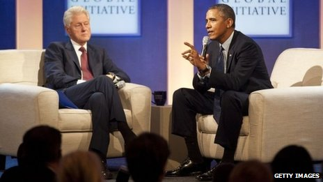 Former US President Bill Clinton (left) listens to US President Barack Obama at the Clinton Global Initiative in New York City on 24 September 2013