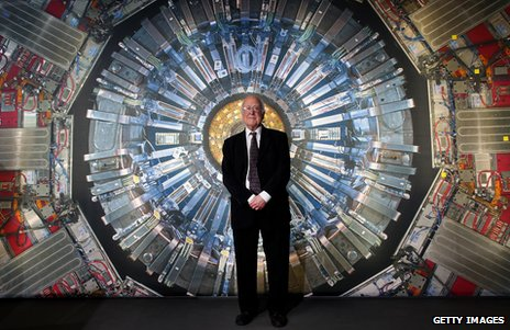 Prof Peter Higgs in front of a photograph of the Large Hadron Collider at London's Science Museum