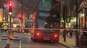 Bus behind police tape
