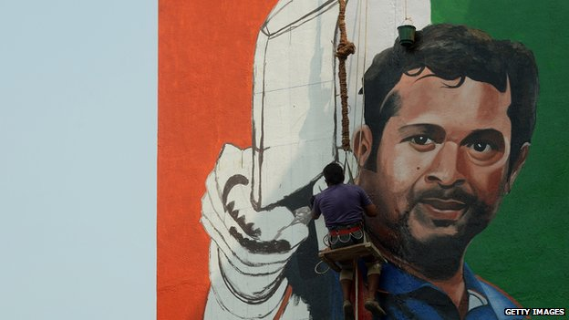 Indian artist Ranjit Dahiya works on a mural of cricketer Sachin Tendulkar on the wall of a sports club building in Mumbai on November 8, 2013