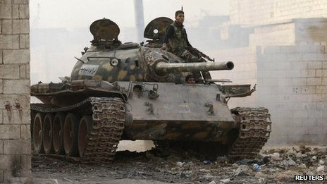 A rebel fighter from Liwa al-Tawhid on board a tank in Aleppo (12 November 2013)