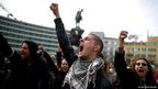Bulgarian students shout anti-government slogans during a protest in front of the parliament in central Sofia