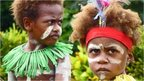 Two children celebrate the Queen's Baton Relay arrival in Papua New Guinea