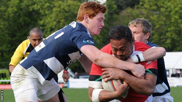 Jack Tovey (left) makes a tackle