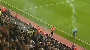 Linesman is struck by smoke canister