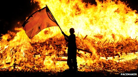 Child with union flag at 11th night bonfire