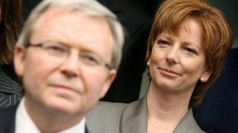 A file photo taken on December 13, 2006 shows Julia Gillard (R) looking at Kevin Rudd (L)