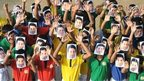 Students wear masks of Sachin Tendulkar in Nagpur, India, 13 November 2013