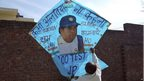 "Jagmohan Kanojia holds up a kite with a portrait of Sachin Tendulkar and a message that reads: ""Never say farewell"" in Amritsar, 13 November 2013"