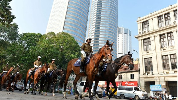 Sri Lankan traffic policemen on horseback patrol a street in Colombo on November 14, 2013, ahead of the Commonwealth Heads of Government (CHOGM) meeting.