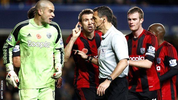 West Brom protest to referee Andre Marriner at Stamford Bridge