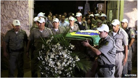 The exhumed remains of Brazils former president Joao Goulart are carried from the Jardim da Paz cemetery in Sao Borja on 14 November, 2013