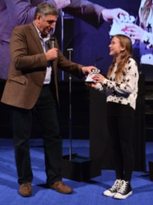 Agnieszka Kolaczynska receiving her award from actor Jim Carter