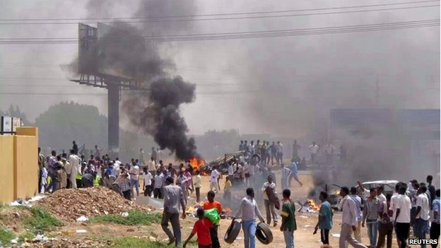 People take part in protests over fuel subsidy cuts in Khartoum, Sudan - 25 September 2013