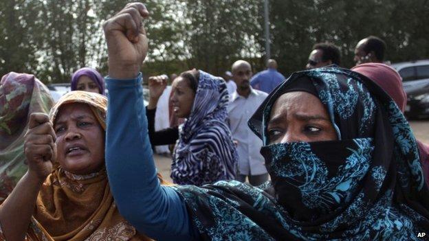 Sudanese relatives of Salah Sanhory, who was killed on Friday 27 September 2013 at his funeral in Khartoum, Sudan