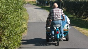 Man travelling on a 'flakmoped'