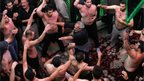 Iranian Shiite Muslims beat their heads and chests during Ashura rituals at Tehran's Karbalaiya Mosque on 14 November