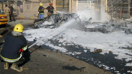 Firefighters put out a car fire after a blast in Kirkuk, Iraq (14 November)