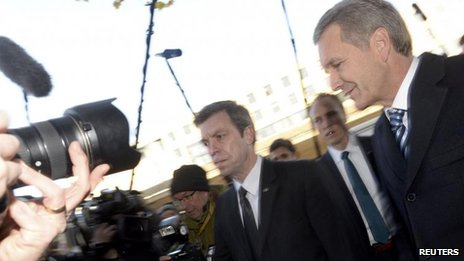 Germany's ex-President Christian Wulff (right) arriving for his trial at the regional court in Hanover (14 November)