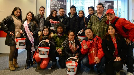 A group of British Filipinos with donation buckets for the Red Cross Typhoon Haiyan appeal