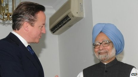 India's prime minister Manmohan Singh shakes hands with British Prime Minister David Cameron ahead of a meeting in New Delhi
