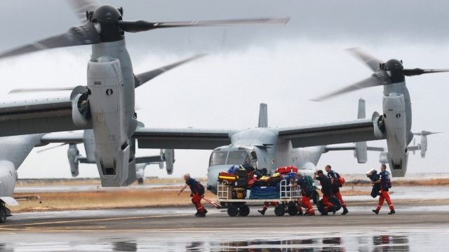 US Bell Boeing V-22 Osprey arrive at the airport to transport humanitarian workers to typhoon affected areas on November 14, 2013 in Tacloban, Leyte, Philippines to help people affected by typhoon