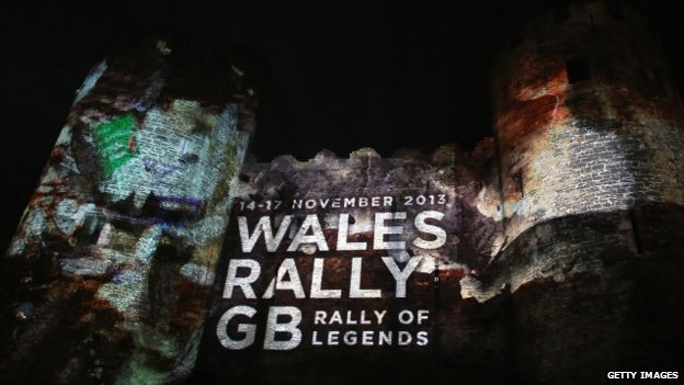 The castle in Conwy lit up for the rally's start on Thursday
