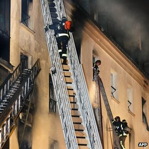This picture taken on April 15, 2005 in Paris shows firefighters working on a fire at the Paris-Opera Hotel