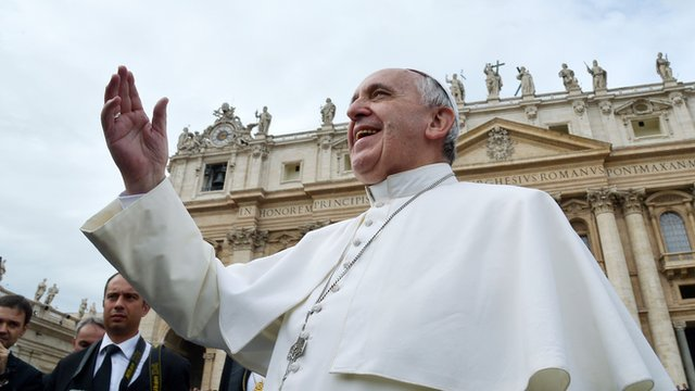 Pope Francis smiles at pilgrims in Saint Peter's square at the Vatican