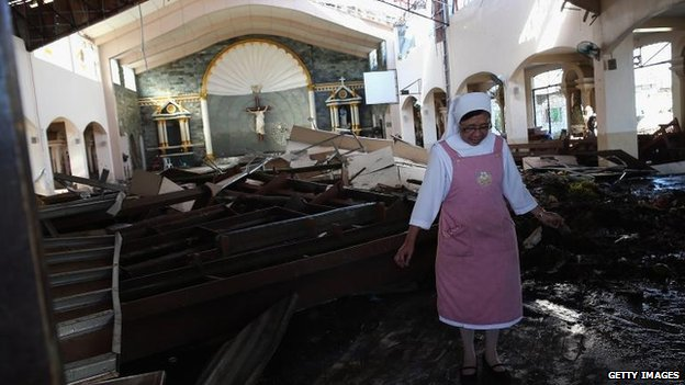 Nun wades through wreckage in St Joseph Church, Tacloban (15 November)