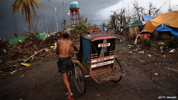 Man pushes a rickshaw, Leyte (14 November)