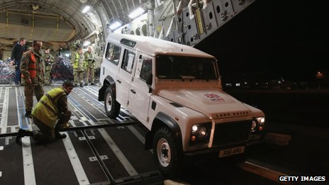 A Land Rover is loaded onto a C-17 aircraft at RAF Brize Norton